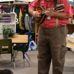 Joel playing the mandolin for the class at Yale Elementary