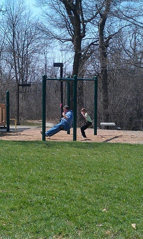 Me swinging on a swingset with Daddy!